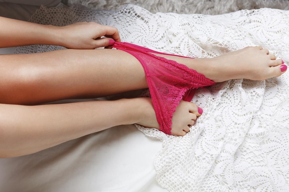 Woman Taking Off Sexy Panties